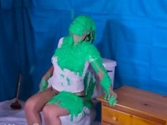 Girl has disgusting green slime dumped on her while using the toilet
