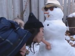 fuck snowman in the yard of house