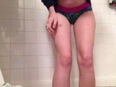Amateur peeing in her panties in bath