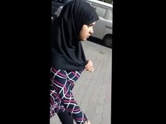 Arab teen with big tits and high heel spying in street