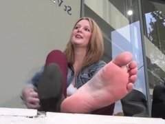 Girl takes boots off to show sexy soles and feet