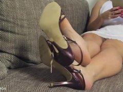 Feet and high heel sandals shoeplay