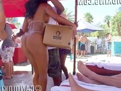 Ebony bikini babe shows off her round bubble butt in a thong bikini!