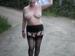 mature lady walks in just heels and stockings