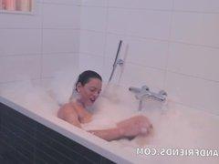 Big tits and cock shemale masturbating while taking a bath