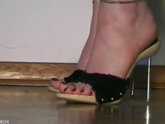 Bare feet in high heel mules