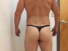 Posing in black thong