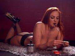 Sexy Kara Carter smoking topless using a cigarette holder