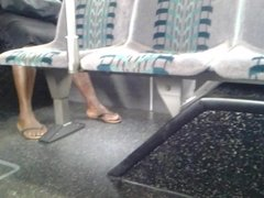 Candid mature feet on bus