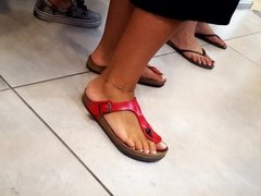 close up her white pedicured feets toes