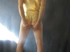 Leotard sissy shakes his feminine ass.
