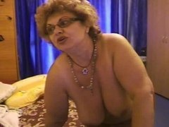 Mature curly haired bitch with saggy tits