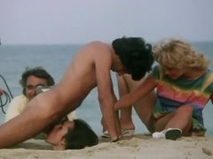 Blowjob on the beach and cumshot .  Vintage movie.