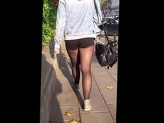 girl with nice legs in black pantyhose and shorts