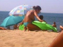 Topless Women on Beach