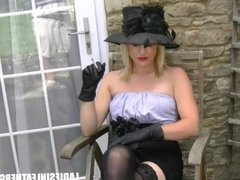 Smoking blonde lets you upskirt at her naked shaved pussy in leather gloves