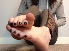 Soles and toes feet tease with painted toes.