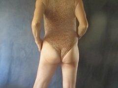 Leotard bitch shows his feminine looking sissy bottom.