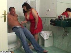Big boobs mom riding his cock in the bathroom