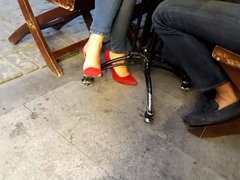 her sexy feet teasing cafe in red high heels