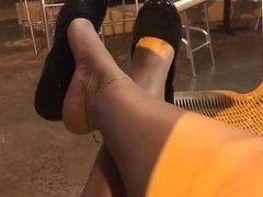Ebony feet shoe dangling