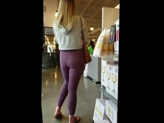 Candid blonde in yoga pants with tight ass