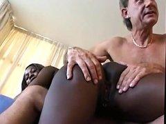 African slut enjoying pussy ass mouthfuck by 3 men.
