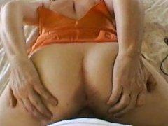 In a little nightie doing her 'cum fuck me' ass tease