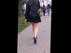 #81 Smoking girl with nice legs in mini skirt and pantyhose