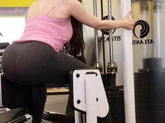 Super sexy teen in leggings working out in gym