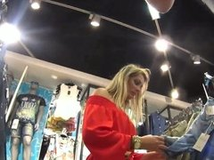 Upskirting hot blonde milf in red dress at store
