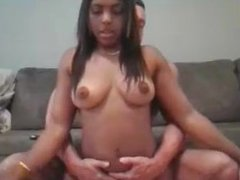 Black babe fucks white stud on her couch