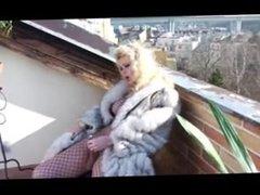 Shemale in fox fur coat masturbating and cumming