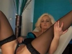Blonde masturbates on the stretcher
