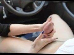 Juicy girl giving an amazing handjob in car