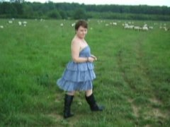 Small titted milf walking nude with the sheep