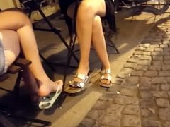 girls sexy crossed legs sexy feets at cafe