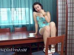 Vita enjoys coffee and masturbates on her table