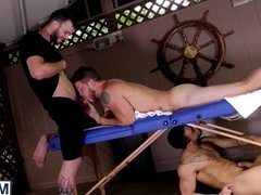 Muscular studs fucking in threesome after a hot massage