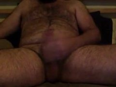 Bearded guy cums and tastes his cum
