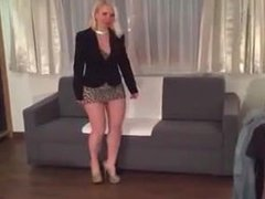 Exciting Lady in a short dress walks around the house