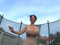 Huge fake tits bouncing on a trampoline