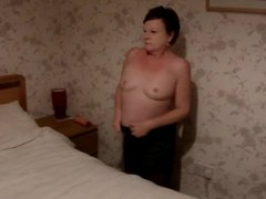 Small titted milf suzy stripping off in the bedroom.
