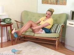Blonde Milf strip teases pussy in retro lingerie nylon heels