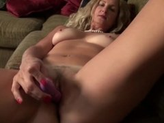 American housewife Brenda masturbating on the couch