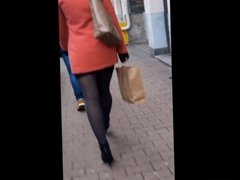 #97 Woman with sexy legs in mini skirt and high heels