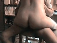 Wife rides husband on the chair