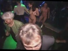 Two girls dance naked in a night-club