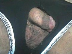 cock and balls coming out of shorts