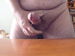 Licking up my cum and shooting on the table